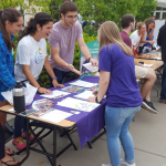 Members of the Change Maker club talk to students during a club fair. The club is just one part of several St. Thomas programs with a common purpose. (Peter Monahan/TommieMedia).