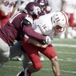 Augsburg defensive lineman Jermaine Borward sacks St. John's quarterback Ben Alvord in one of the few bright spots for the Auggies, who fell 49-0 to the Johnnies on Saturday in Minneapolis. (Carlee Hackl/TommieMedia).