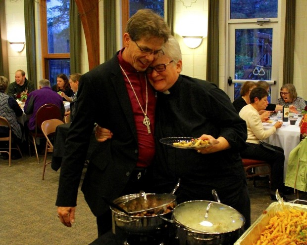 At the reception for his bishop ordination ceremony on Saturday, Rev. Martin Shanahan receives a hug from fellow pastor Rev. Colleen Woodley. Shanahan attended the Saint Paul Seminary at the University of St. Thomas before converting to Old Catholicism and starting his own church, Spirit of Hope, in Sunfish Lake, Minnesota. (Photo courtesy of Martin Shanahan)
