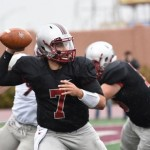 Hamline quarterback Justice Spriggs looks for a receiver Saturday in the Pipers' home victory over Augsburg. Spriggs passed for 317 yards and 5 touchdowns.