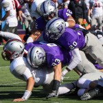 St. Thomas defensive linemen Micah Hausman and Anthony King-Foreman take down Hamline quarterback Justice Spriggs with help from St. Thomas defensive back Jack Dwyer. Saturday's halftime score was 43-20 with the Tommies in the lead. (Carlee Hackl/TommieMedia)