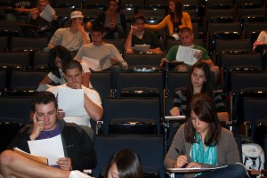 <p>A group of freshman students look over their Philosophy syllabi. (Dan Cook/TommieMedia)</p>