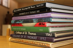 <p>All old St. Thomas yearbooks, such as these, will be archived online after the switch to digital. (Ashley Stewart/TommieMedia)</p>