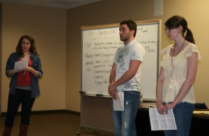Entrepreneurship 200 students Angie Hasek, Peter Burke and Kara Gamelin present their business proposal based on a lemonade stand concept to their group's mentor. (Kelsey Broadwell/TommieMedia)
