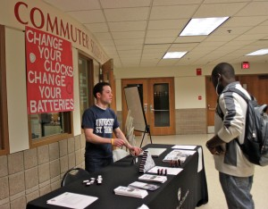 <p>Mike Orth, Undergraduate Student Government sophomore class president, talks to a student about fire safety. (Theresa Malloy/TommieMedia)</p>