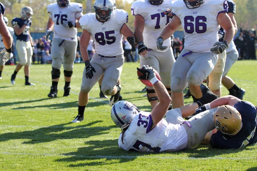 <p>Senior Colin Tobin slides into the end zone for a touchdown. (Rita Kovtun/TommieMedia)</p>