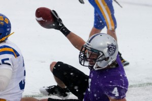 <p>Senior wide receiver Fritz Waldvogel is all smiles in the snow against St. Scholastica last weekend. Waldvogel has 12 touchdowns, 1,418 all-purpose yards and 61 receptions for 940 yards in 11 games this season. (Rita Kovtun/TommieMedia)</p>
