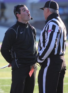 Coach Glenn Caruso has a conversation with a referee during the semifinal playoff game against Wisconsin-Whitewater. (Ryan Shaver/TommieMedia)