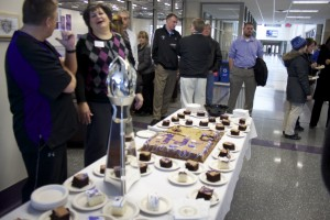 The St. Thomas community gathered to honor coach Glenn Caruso. His coach of the year trophy was on display, and cake was provided. (Cynthia Johnson/TommieMedia)