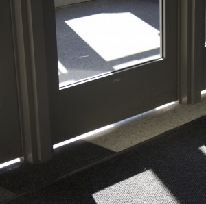 <p>Junior Emily Schmitz and sophomore Alex Niestrom agree that the mice are getting in under the doors to the AARC. (Terese Quarberg/TommieMedia) </p>