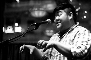 """<p>Heiu Minh Nguyen performs an original poem. Nguyen compared poetry competitions to """"the competition of playing tag with your friends."""" (Submitted Photo)</p>"""