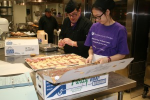 <p>Catering Service employees work on preparing sandwiches for an on-campus club meeting, Monday, Feb. 7.  (Jake Swansson/ TommieMedia)</p>