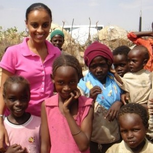 St. Thomas graduate Semhar Araia visits with the local children in Darfur. She asked one of the community elders how she could help the conflict in Sudan. His answer greatly affected Araia's life and her identity as a member of the African diaspora. (Submitted Photo)