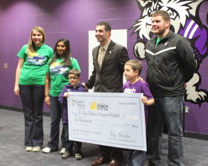 <p>Coach Glenn Caruso, who won the Liberty Mutual Coach of the Year award for the second year in a row, presented his $10,000 donation to St. Jude Children's Research Hospital Tuesday. (Cynthia Johnson/TommieMedia)</p>
