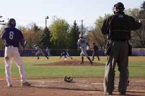 Junior shortstop Jon Kinsel watches teammate Jack Hogan steal second during the second game. Kinsel picked up an RBI later in the at bat, scoring St. Thomas' first run. (Anastasia Straley/TommieMedia)
