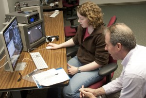 Junior Colleen Schreier edits video with Professor Tim Scully in the Avid lab during his COJO 360 Videography: Television Production in the Field course that may count toward the film minor. (Laura Landvik/TommieMedia)