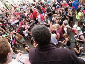"""Students overlook the block party from a balcony on Mifflin Street. Horsager said that Mifflin is """"a way of life at Madison."""" (Photo courtesy of Dustin Klitzke)"""