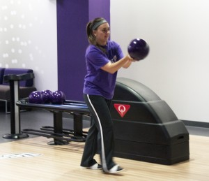 Freshman Bailey Schirmers takes a look down the lane before releasing the bowling ball. Cosmic bowling and a bowling league contributed to the success of the Anderson Student Center's bowling alley this semester. (Baihly Warfield/TommieMedia)