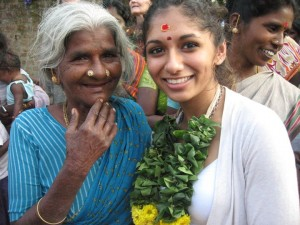 Geena Maharaj is greeted by hordes of Indian women in a small village south of Chennai, India. She traveled to the country during January Term of 2011 for a study abroad Theology course. (Geena Maharaj/TommieMedia)