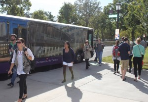 <p>St. Thomas students get on and off the shuttle bus at the St. Paul campus. The shuttles will be offering an updated card reader to make sure only authorized students are riding. (Laura Landvik/TommieMedia)</p>