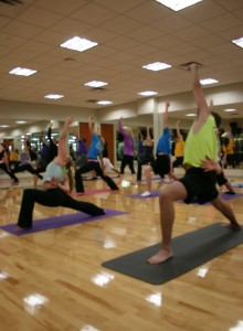<p>Students hold the warrior pose in the Intermediate Yoga class on Sept. 25. Yoga has been one of the most popular classes offered at the AARC. (Gabrielle Martinson/TommieMedia)</p>