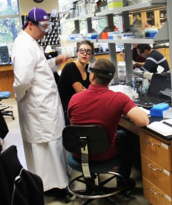 <p>Friar Patrick Daniel Tobin instructs a biochem lab in his full Dominican habit. Tobin holds two positions at St. Thomas: in campus ministry and one as a chemistry professor. (Kayla Bengtson/TommieMedia)</p>