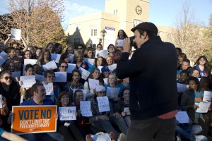 Senior Mark Koranda takes a photo of students in opposition to Minnesota's marriage amendment in the Lower Quad. Junior Chris Gelke organized the event and said about 250 students attended. (Tarkor Zehn/TommieMedia)