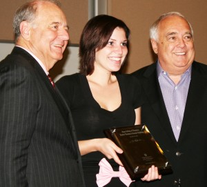 <p>Senior, Keona Tranby, wins the $10,000 scholarship prize in the Fowler Business Concept Challenge Friday. Ron Fowler and Chris Puto presented her with the prize. (Kayla Bengtson/TommieMedia)</p>