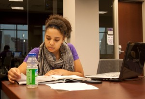 <p>Senior Dease Scholar Kia Johnson studies in the Anderson Student Center Tuesday. There have been no plans to change the Dease Scholar Program in 2013 after the Rev. Dennis Dease leaves. (Gabrielle Martinson/TommieMedia)</p>