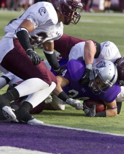 <p>Freshman running back Brenton Braddick gets stopped by the Augsburg defense a yard from the goal line. On the next play, freshman running back Dominic Truoccolo finished the drive with a touchdown run, bringing the score to 30-7 Tommies. (Meg Thompson/TommieMedia)</p>
