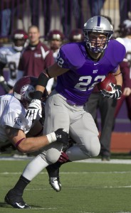 <p>Freshman running back Jack Kaiser fights off an Augsburg defender. Kaiser ran for 110 yards Saturday against the Auggies. (Meg Thompson/TommieMedia)</p>