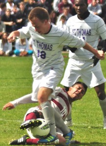<p>Freshman forward Ryan Bernhardt captures the ball from junior Augsburg College's junior forward Ryan Schlittler. St. Thomas finished off the season with an overall record of 11-4-3 and secured a spot in the MIAC playoffs. (Ali Stinson/TommieMedia) </p>
