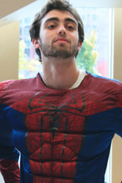 <p>Sophomore Jesse Stone sports a superhero outfit during his Fowler Business Challenge presentation for Superhero Simulation Service. Stone and his business partner Mariann Kulielka were awarded $6,000 in scholarships for the concept. (Briggs LeSavage/TommieMedia)</p>