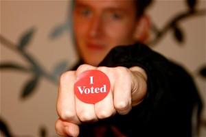 <p>Sophomore Garrett Smetana shows his pride in exercising his right to vote. Students across campus also exercised this right Tuesday, and a U.S. National Institute on Child Health and Human Development study argues that students may have voted according to their parent's views. (Kayla Bengtson/TommieMedia) </p>
