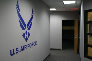<p>The Air Force symbol can be seen in the display window facing the hallway of MHC. This area includes a reception area, offices, a computer room, a library, two classrooms and a storage area. (Laura Landvik/TommieMedia)</p>