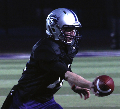 <p>Quarterback Matt O'Connell practices a hand off Tuesday night. O'Connell went 15-25 for 197 yards and two touchdowns in last week's win over St. Norbert. (Ross Schreck/TommieMedia)</p>