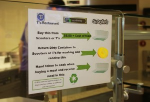 <p>Advertisements have bee put up around T's for the eco-friendly reusable containers. They cost $5 and can be reused for every meal purchased at the restaurants. (Tarkor Zehn/TommieMedia)</p>
