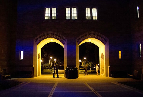11:59 p.m. A couple has less than a minute left to wait to partake in the True Tommie tradition of kissing under the arches at midnight. (Rita Kovtun/TommieMedia)