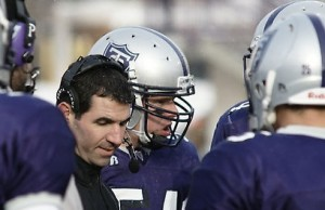 <p>Caruso speaks with players during Saturday's game. (John Kruger/TommieMedia)</p>