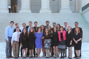 Catholic Studies Leadership Interns stand on the steps of the United States Supreme Court Building.
