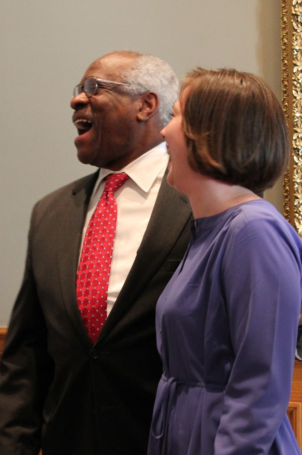 Quinlan Keller, then a junior, shares a laugh with Supreme Court Justice Clarence Thomas. Keller and 28 other students visited Washington, D.C., through the Catholic Studies Leadership Intern Program.