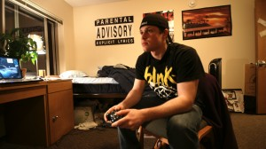 Senior Tony Forneris plays an XBOX 360 in Flynn hall. (John Kruger/TommieMedia)
