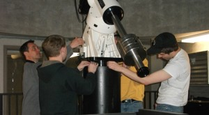 Students from professor Gerry Ruch's astronomy class prep the telescope for use next fall. (Miles Trump/TommieMedia)