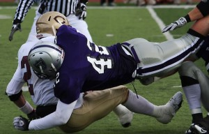 <p>Senior Wyatt Delgado sacks Concordia quarterback Andrew Larson in last years game. (Marc Lane/TommieMedia)</p>