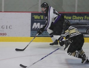 <p>Senioor defenseman Kyle Kranz states up the ice in a game against St. Olaf. The defense had a strong outing against Augsburg holding the Auggies scoreless.</p>