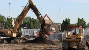 Construction crews move dirt at the future location of the Anderson Student Center. (Michael Ewen/TommieMedia)