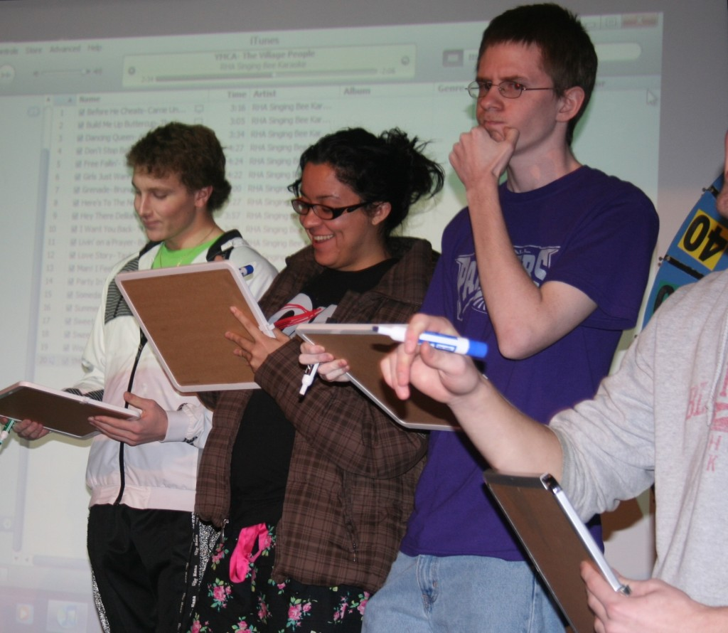 <p>Students try to guess the name of a song Monday night at the Residence Hall Association's Singing Bee. (Drew Landon/TommieMedia)</p>