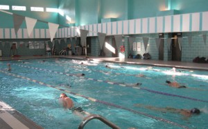 <p>As part of their tapering regiment before the championships, the men's team swims laps in McCarthy Gym on South Campus. (Ashley Bolkcom/TommieMedia)</p>