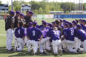 Coach Chris Olean holds a team huddle after St. Thomas' 10-5 loss to St. John's in the MIAC Championship. The Tommies hope to receive an at-large bid to the NCAA tournament with their 34-8 overall record. (Hayley Schnell/TommieMedia)