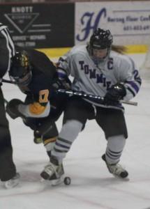 Senior captian Kelley Fallen skates past a Gustavus defender. (Rebecca Omastiak/TommieMedia)